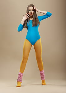 woman wearing blue long-sleeved bodysuit and yellow tights