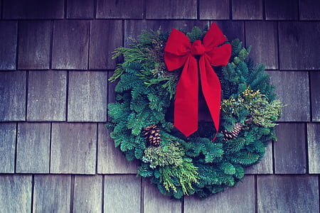 green wreath with red ribbon