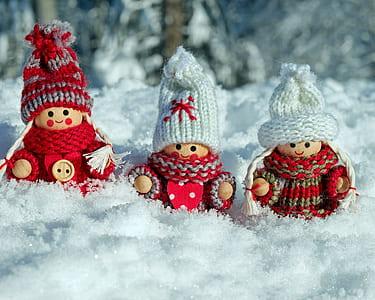 three mini figures on snow