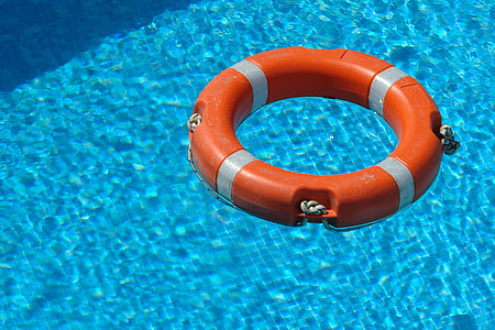 red and gray inflatable ring on pool