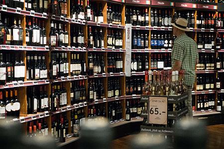 Man choosing wine in a wine store