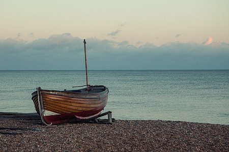 A boat sits on the shore on a tranquil sunset in Southern England, image captured with a Canon 5D