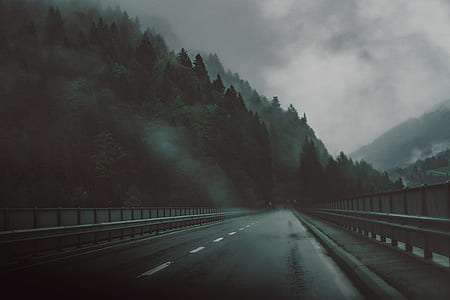 photo of dark road on mountain