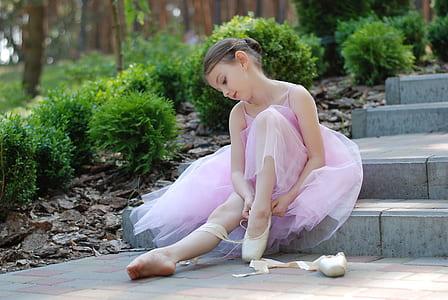 beliran girl sitting on gray concrete stair