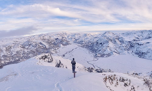 man on top of mountain with snows