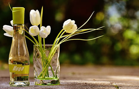Clear Glass Hugo Bottle With White Flowers