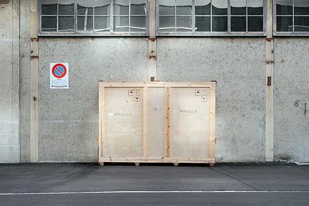 beige wooden storage box near gray concrete wall