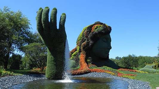 woman and hand topiary panorama photography