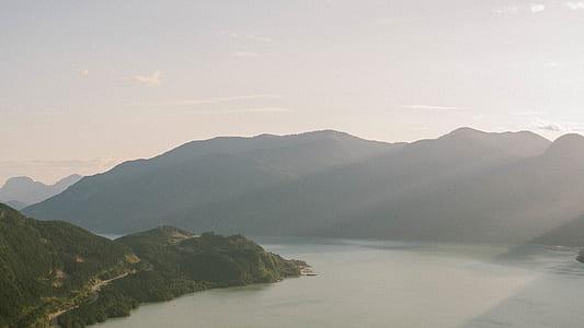 lake between green mountains at daytime