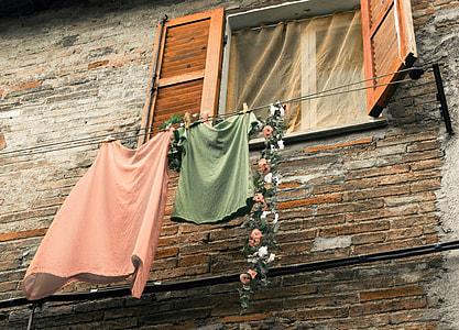 green shirt and pink skirt on gray clothesline