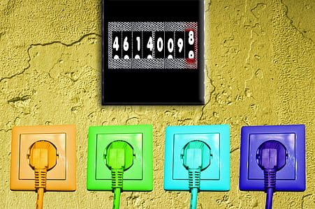 four assorted-color power plugs