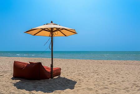 umbrella with lounge chair near beach
