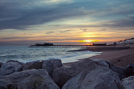 Wide angle shot taken at sunset of the pier and seafront at Hastings, East Sussex, England