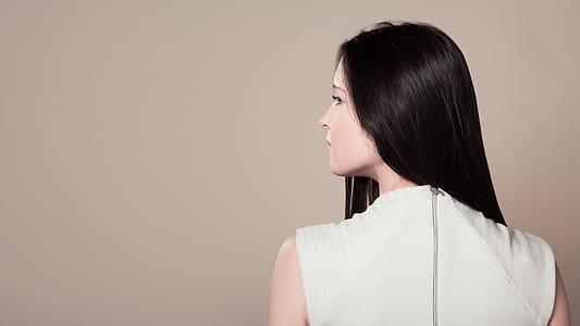 woman wearing white sleeveless shirt