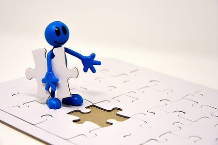 blue character holding jigsaw puzzle