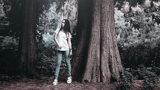 woman in shirt beside tree