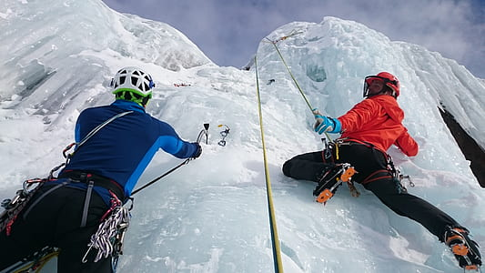 two person climbing on ice wall
