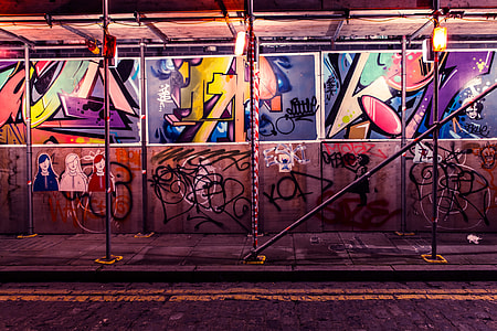 Street art and graffiti by building scaffold in Shoreditch, East London