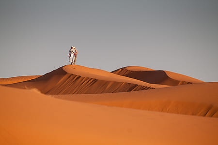 two person in desert during daytime