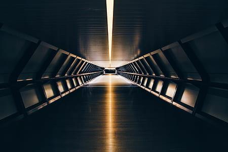 path in between gray steel walls