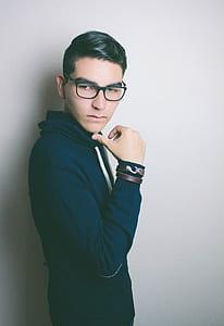 Person Wearing Black Eyeglasses and Blue Hoodie Jacket