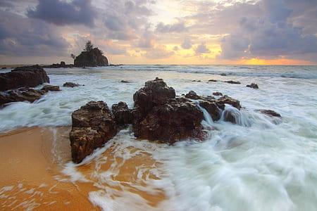 brown rock on seashore photography