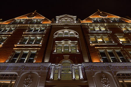 Upward View of Brown Building at Night