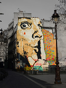 selective color photography of man's face graffiti