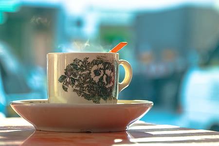 White and Green Ceramic Mug on White Ceramic Plate