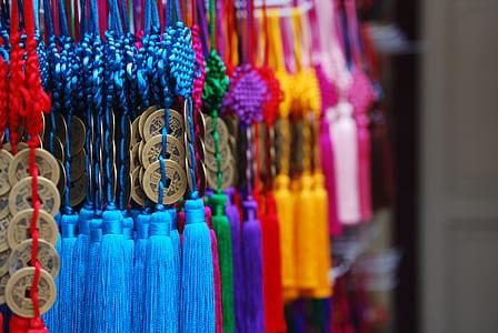 pile of assorted-color tasseled misbaha prayer beads