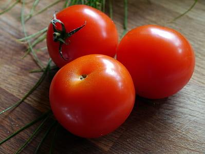 three ripe tomatoes
