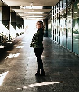 woman in jacket standing in building