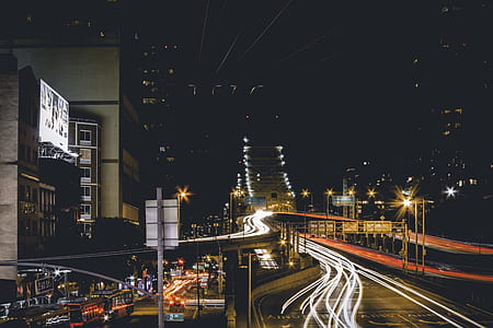 long-exposure photography of vehicles passing on road