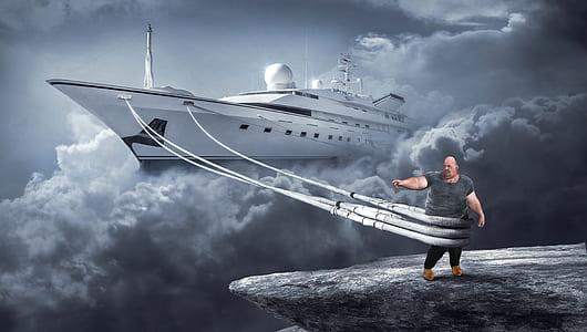 man in gray shirt dragging white cruise ship through clouds