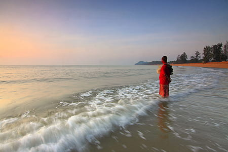 Person on the Seashore during Sun Set