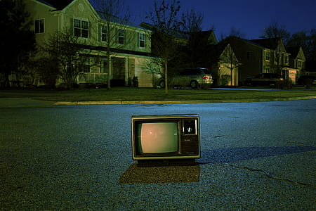 vintage TV on gray cement road