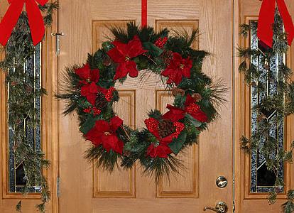 red and green wreath on door