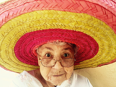 woman in pink and yellow stripe straw sun hat close up photo