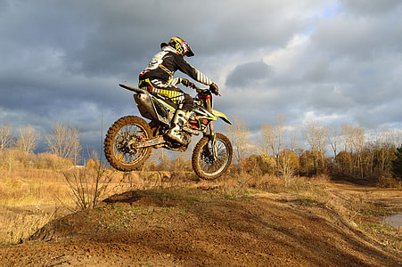 man riding yellow and white dirt motocross bike