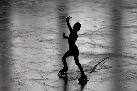 grayscale photograph of ice skier