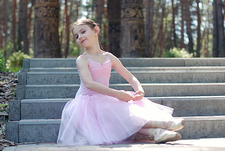girl wearing a pink ballerina suit