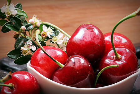 red Cherry fruit in white ceramic bowl
