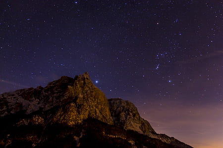 brown mountains with purple galaxy stars
