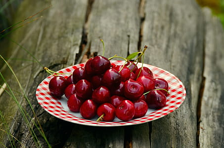 bunch of cherries on plate