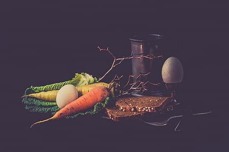 orange carrots, two white eggs, and orange vegetable