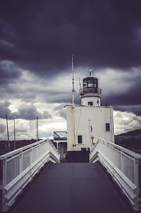 View of Cloudy Skies on Lighthouse