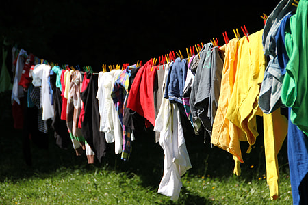 assorted-color clothes hang on drying rack