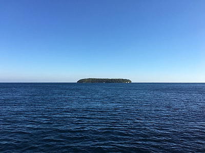islet in the middle of ocean