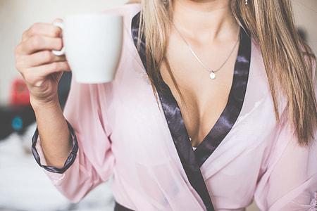 Wonderful Girl in Silk Nightgown Enjoying Morning Tea