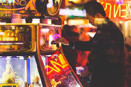 Man at Neon Lit Game